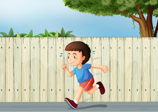 A little boy running at the road Stock Image