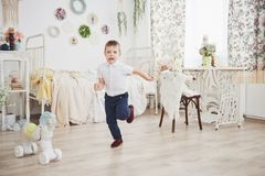 Little boy running in the room. It`s happy that my mother came to take home from the mothers` garden