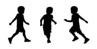 Little boy running silhouettes set 2. Set of three silhouettes of a little schoolboy about 6 years old running and playing with a ball Stock Photography