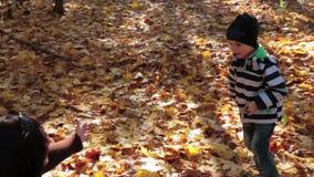 Little Boy Running To Parents n Autumn Park stock video footage