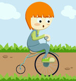 Little boy running tricycle. Illustration about a little red haired boy learning how to ride his new tricycle in a sunny day at the park Stock Photos