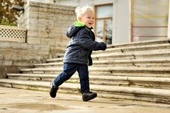 Little boy runs. Near house Stock Image