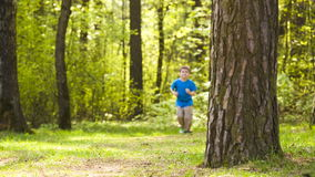 Little boy runs park. Little boy playing sports jogging in park stock video