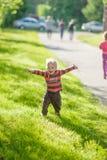 A happy little boy run towards Stock Photos