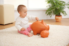 Little boy's early savings Stock Photos
