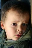 Little boy's face. Little boy expressing fatigue. sadness and yet curiosity royalty free stock images