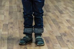 Little boy`s feet in sandals. Summer children`s shoes Royalty Free Stock Photo