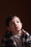 A little boy's thoughtful gaze. A little boy gazing off to the side in a thoughtful way Royalty Free Stock Photo