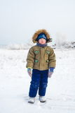 Little boy with a sad face outdoors winter Royalty Free Stock Photos