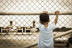 Little boy sad standing alone Royalty Free Stock Photos