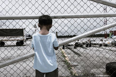 little boy sad standing alone ,vintage tone Stock Photos