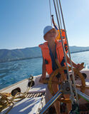 Little boy at sail boat wheel Stock Photography