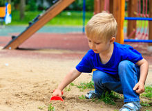 Little boy in the sandbox, daycare concept Royalty Free Stock Image