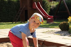 Little boy in the sandbox Stock Images