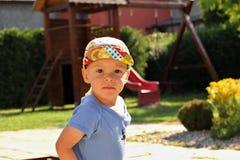 Little boy in the sandbox Stock Photos