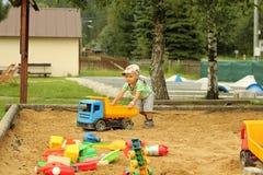 Little boy in the sandbox. Royalty Free Stock Photo