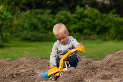 Little boy in the sandbox. Royalty Free Stock Images