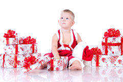 Little boy Santa Claus with Christmas gifts Stock Photography
