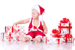 Little boy Santa Claus with Christmas gifts Royalty Free Stock Image
