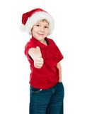 Little boy in the santa claus hat Stock Photos