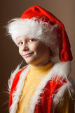Little boy in Santa Claus suit Stock Images