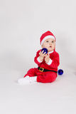 Little boy in Santa clothes Stock Photos