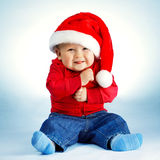 Little boy with santa costume Stock Photos