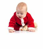 Little boy in Santa costume looking down Stock Photography
