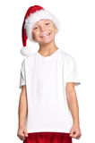 Little boy in Santa hat. Portrait of happy little boy in Santa hat isolated on white background Stock Photography