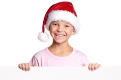 Little boy in Santa hat. Portrait of happy little boy in Santa hat with white blank Stock Photo