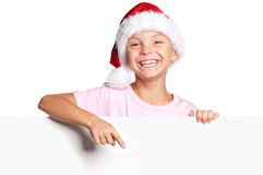 Little boy in Santa hat. Portrait of happy little boy in Santa hat with white blank Stock Photos