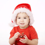 Little boy with Santa hat Stock Images