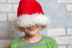 Little boy with Santa hat. Cute Little boy with a Santa hat Stock Images