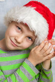 Little boy with Santa hat. Cute Little boy with a Santa hat Royalty Free Stock Photography