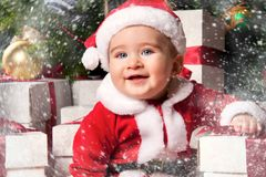 Little boy in Santa hat. With a gift boxes Stock Photo
