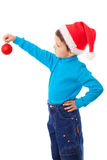 Little boy in Santa hat with red decoration Stock Images