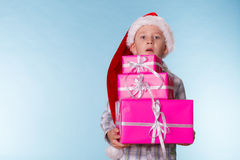 Little boy santa helper hat with pink gift boxes Royalty Free Stock Image
