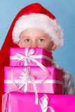 Little boy santa helper hat with pink gift boxes Stock Photo