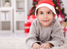 Little boy with a Santa red hat smiling in Christmas night,Chris Royalty Free Stock Image
