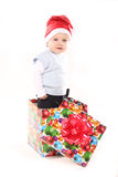 Little boy in Santa's hat. Smiling little boy with Santa's hat in a big gift box. isolated on a white background Royalty Free Stock Photography