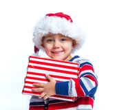 Little boy in Santa's hat with gift box Royalty Free Stock Photos