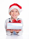 Little boy in Santa's hat with gift box Stock Photography
