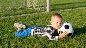 Little boy saves a goal Stock Image