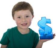 Little boy saving money. Royalty Free Stock Photos
