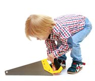 Little boy sawing saw. Royalty Free Stock Photos
