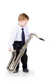 The little boy with a saxophone in hands Royalty Free Stock Images