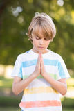 Little boy saying his prayers Stock Photos