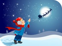 The little boy says goodbye to Santa! Royalty Free Stock Photo