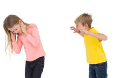 Little boy scaring his sister. On white background Stock Photos
