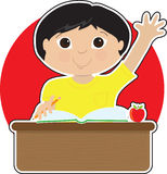 Little Boy at School Asian. A little Asian boy is raising his hand to answer a question in school - there is a book and an apple on his desk Royalty Free Stock Images